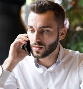 successful-businessman-speaking-by-phone-W5EM9UV.jpg